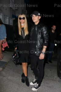165854, Paris Hilton and Chris Zylka, the loved up couple in matching black, arrive at the Revolve Madeworn XRoc96 social club party in Hollywood. Los Angeles, California - Wednesday May 31, 2017. Photograph: © MHD, PacificCoastNews. Los Angeles Office (PCN): +1 310.822.0419 UK Office (Avalon): +44 (0) 20 7421 6000 sales@pacificcoastnews.com FEE MUST BE AGREED PRIOR TO USAGE